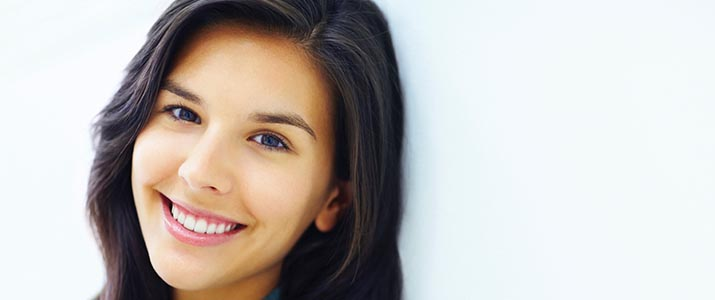 Girl smiling after periodontal care