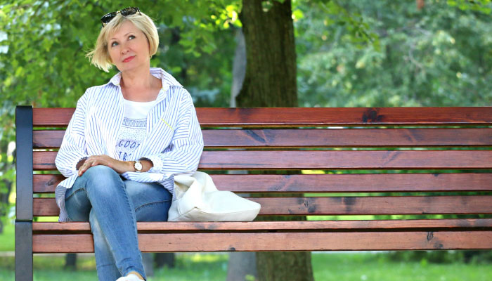 woman sitting on bench thinking